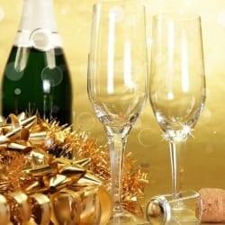Champagne glasses on golden background